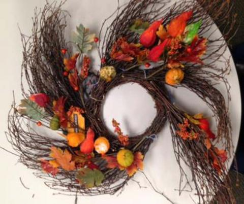 Autumn wreath with silk leaves, pumpkins and gourds