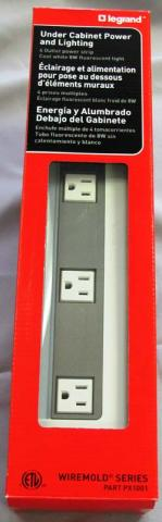 Recalled Legrand Wiremold under-cabinet power strip in the red packaging.