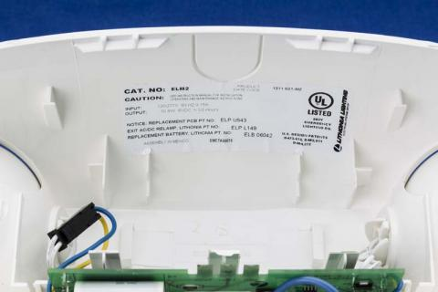 ELM or ELM2 appears on the label inside the fixture's housing.