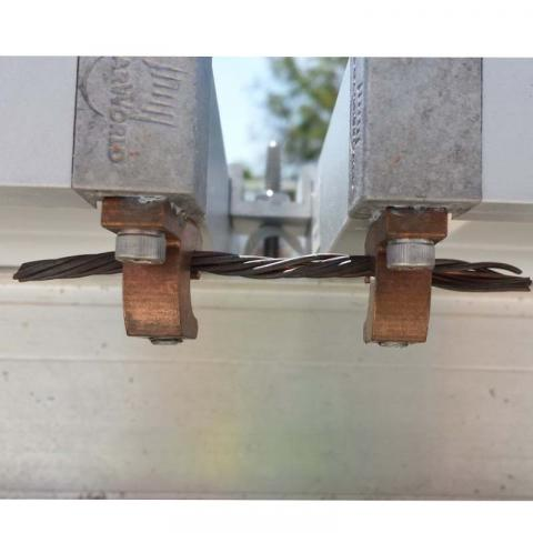 Improper Bare-Copper Lugs Installed on Roof