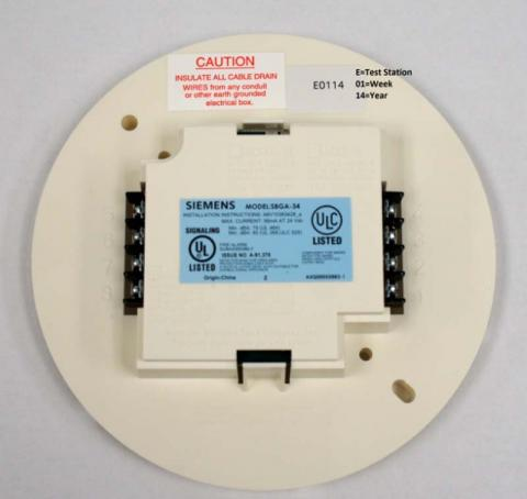 Siemens SBGA-34 Audible Base (Reverse Side)  showing Model Number, Date Code, and screw terminals for connecting to smoke detector panel.