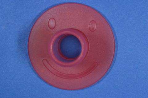 Smiley Face on the top of the base of PouchPop Topper