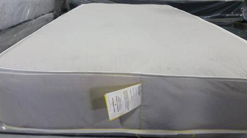 Mattress with federal tag sewn at the foot