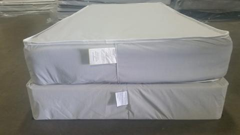 Mattress and foundation with federal tag sewn at the foot of each