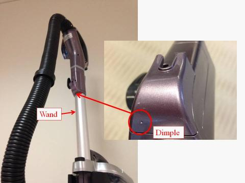 Location of dimple marking on vacuum cleaner