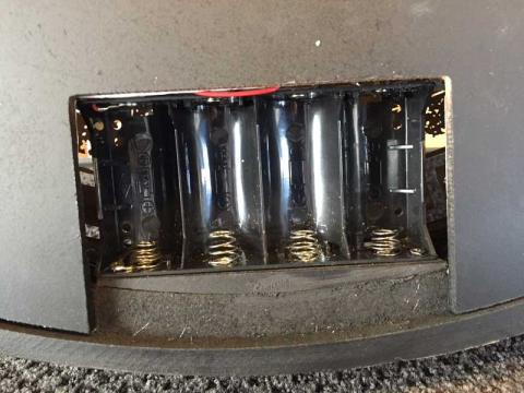 Golda Wall Clock with defective battery springs located at the bottom of the battery compartment.