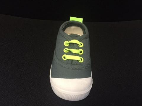 Skidders Footwear gray fabric with green rivets and laces