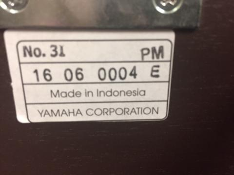 Closeup of label on piano bench