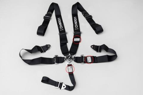 Black 5-Point Camlock Harness Belth with location of label containing manufacture date highlighted.