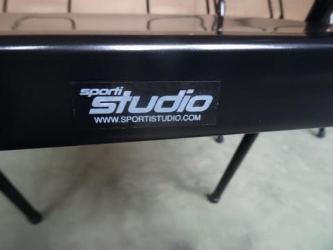The label (positioned on the back of the seat) of the recalled Sporti Studio branded version of the Spiraledge Everyday Yoga Backless Yoga Chair.