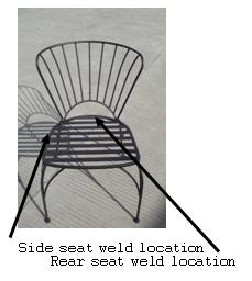 Picture of Recalled Chair with pointers to the side and rear seat weld locations