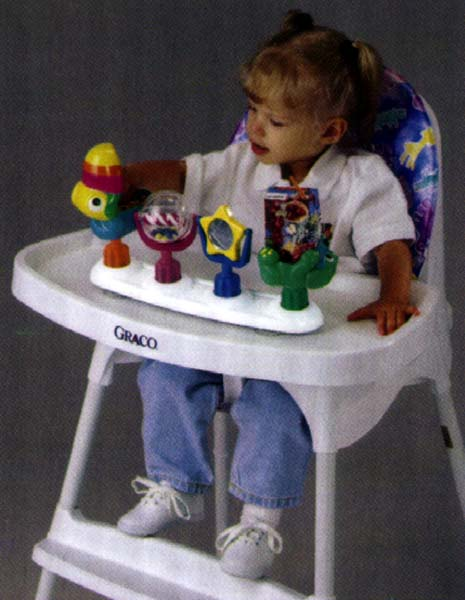 Picture of Girl in High Chair Playing with Activity Tray