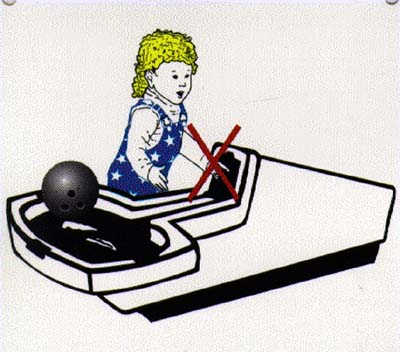 Child putting hand in Bowling Ball Return
