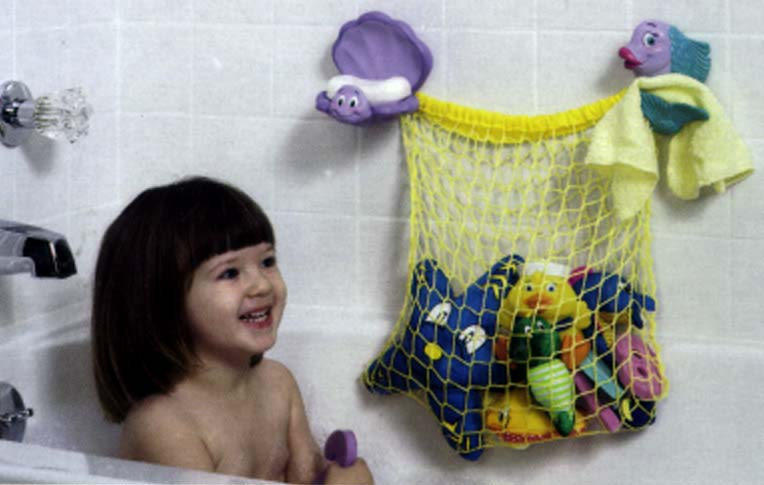 Picture of Girl Smiling at Toy Netting in Bathtub