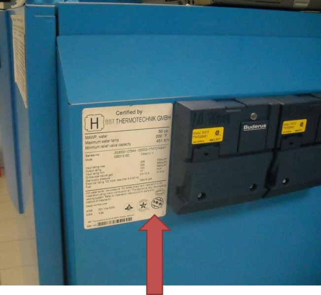 Picture of Recalled Gas Boiler with arrow indicating rating plate