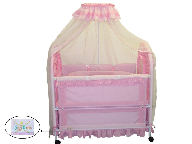 Picture of Recalled Convertible Crib with arrow indicating label