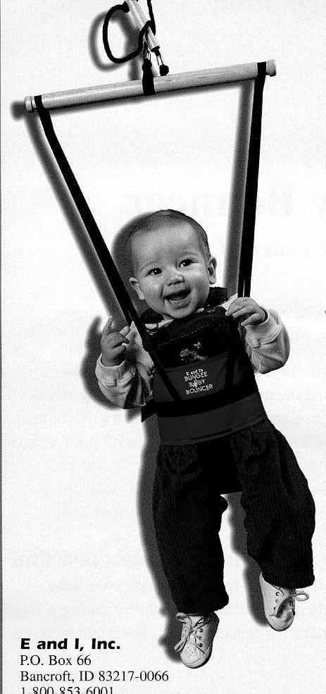 Picture of a baby in a Bungee Baby Bouncer smiling